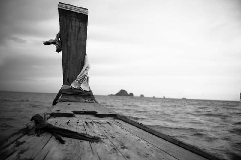 Photo of wood planks with the ocean in the background by Patrick Conaty